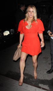 Jessica Simpson has big boobs and is leggy in a red dress